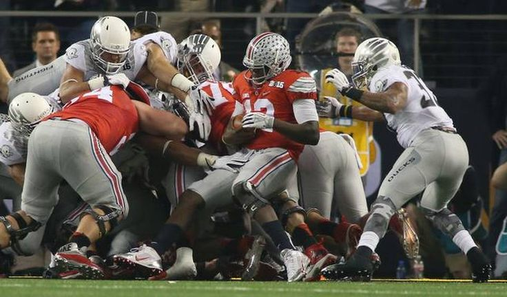 Ohio State Buckeyes quarterback Cardale Jones (12) scores a second quarter touchdown as Oregon plays Ohio State in the CFP National Championship in Arlington, Texas, Monday, Jan. 12, 2015.