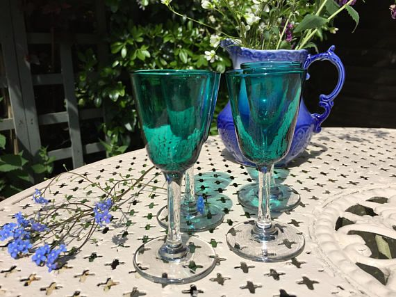 Beautiful Bristol green liqueur glasses or liquor depending on how you spell it, a lovely blue green colour there size suited to that sort of beverage. In really good condition for there age with no chips or obvious marks to mention. They stand 11.5 cms high and the diameter of the cup is 5 cms.