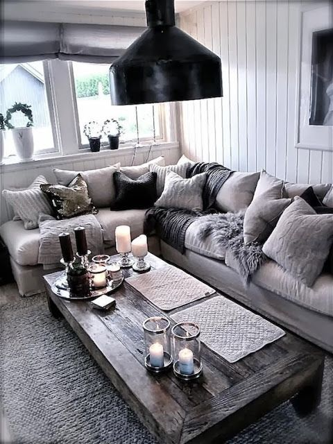 Country chic I just want to snuggle up and drink hot coco in that couch!(: