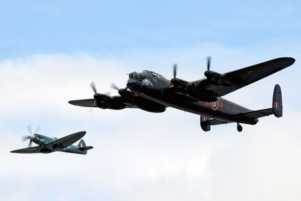 "RAF Battle of Britain Memorial Flight Supermarine Spitfire, and Avro Lancaster ""City of Lincoln""."