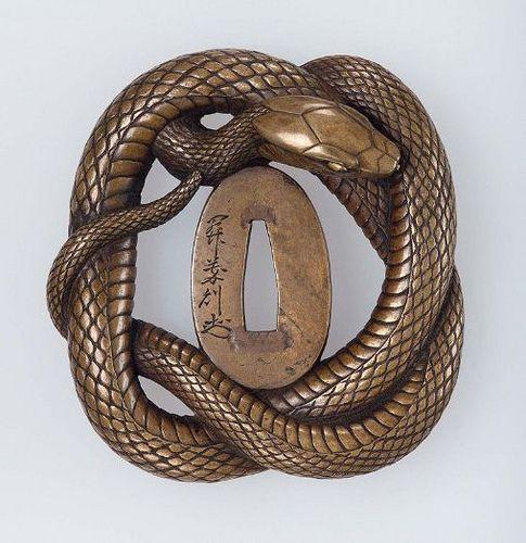 https://flic.kr/p/e4fbUY | Tsuba with design of snake mid 19th century Seki Yoshinori Nara School