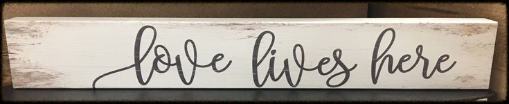 Love Lives Here long, wooden sign