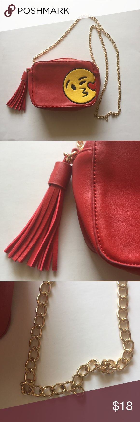 """Olivia Miller Flirty Wink Kiss Emoji Red Purse This is a super cute red purse with the kissing flirt emoji face on it. 7"""" long 5"""" tall and 2"""" are full on the inside . Little wear on bottoms and tassel hook has a small opening. It doesn't slip out.  🚫Sold As Is  📦Monday to Friday Shipping 🚭Non-Smoking Home 👛Bundle For Discount Olivia Miller Bags Mini Bags"""