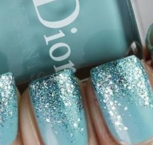 These glittery, glamorous, and simply magical Christmas nail art ideas are easy to execute and spread holiday cheer.: Minty Giltter Wash