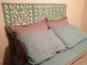 Spray-painted rubber floor mats as DIY headboard. Super easy project!