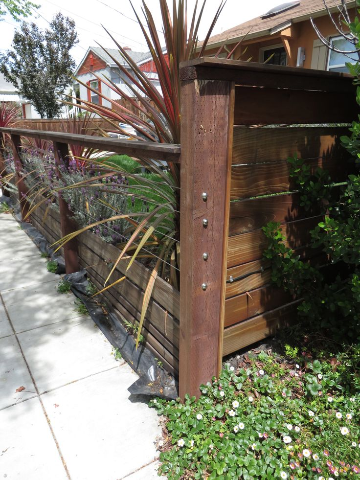 Modern Low Fence With Wood At Bottom Horizontal Wires And