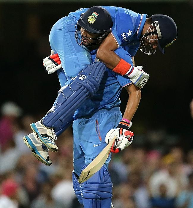 Suresh Raina and Yuvraj Singh celebrate after the win . Yuvraj Singh Lift Suresh Raina .