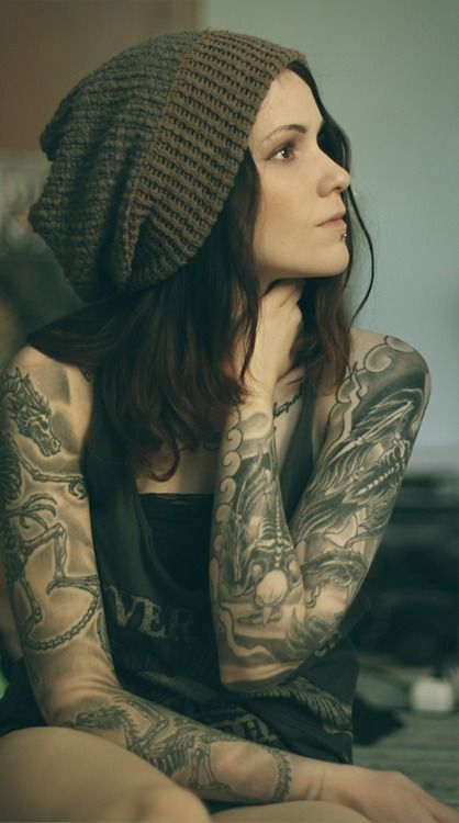 This young lady is showing off some pretty impressive black and grey sleeves.