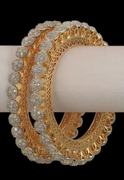 GABRIELLE'S AMAZING FANTASY CLOSET   A Pair of exceptional bangles 18k gold filigree surmounted by pave white diamonds.