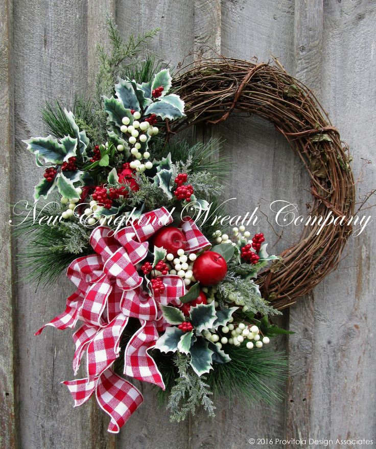Hingham Holiday Gathering Wreath. Bright and eye-catching! Abundant long needle silk pine boughs, delicate frosted pine, holly berry branches and clusters of winter white berries grace the edge of a r