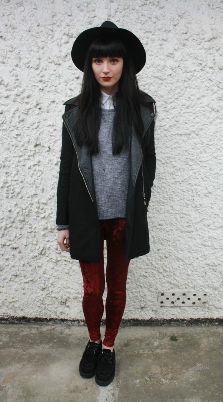 edgy as it has to be, white collar grey jumper red velvet leggings long black jacket