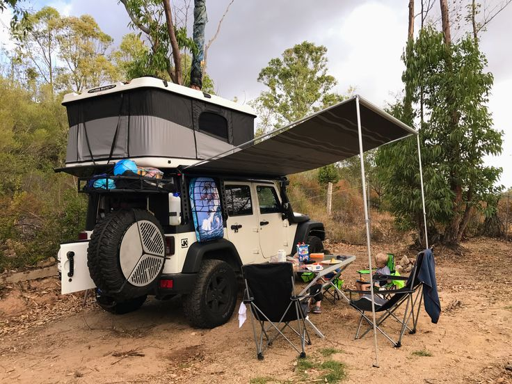 Jeep Wrangler with roof tent James Baround and side shading, spare tire grill