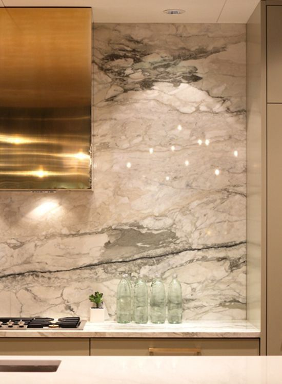 gold hood + green & white marble backsplash | via High-Impact Design ~ Cityhaüs Design: