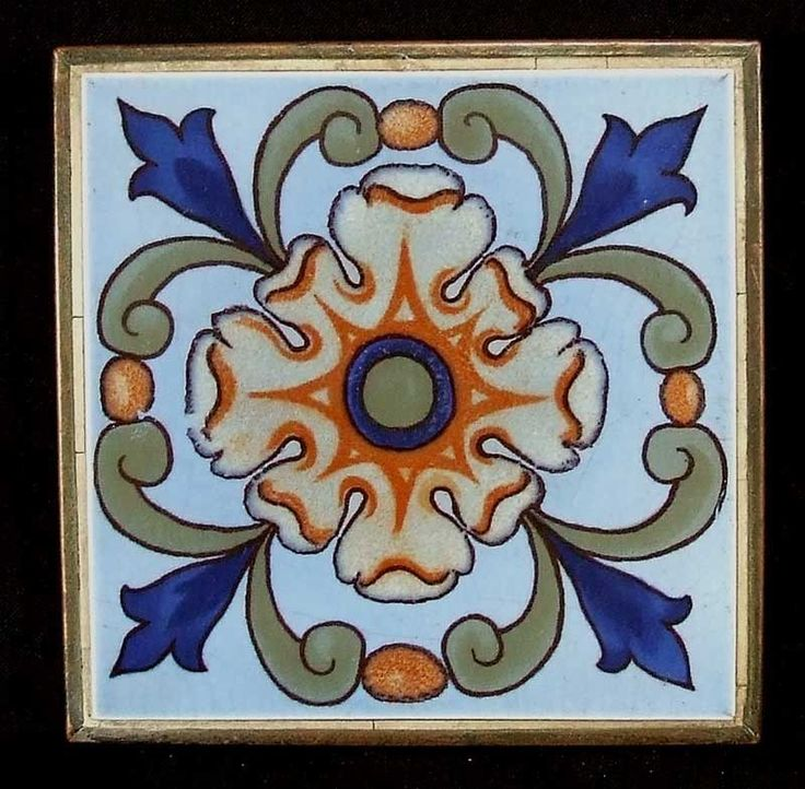 """A pretty tile trivet with a Spanish Revival design in blues set into a 6.5"""" copper trivet, the base having four standing feet. The condition is excellent. The tile was made by the American Encaustic T"""