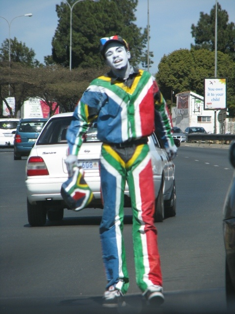 Street mimmic dressed in the South African flag colours-Johannesburg, S.A. lol