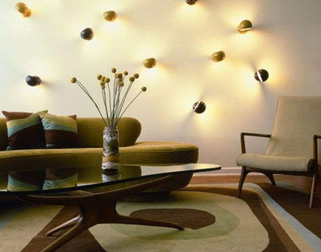 Cool Decorating Idea Of Living Room With Modern Lime Green Sofa And Artistic Coffee Table And Flowers Craft Centerpiece And Arm Chair Also Patterned Area Rug And Cool Wall Lights Decoration