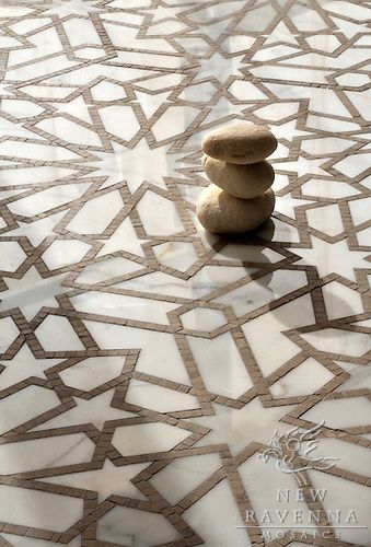 Castilla, a natural stone waterjet and hand cut mosaic shown in Jura Grey honed and Calacatta Tia polished, is part of the Miraflores Collection by Paul Schatz for New Ravenna Mosaics.