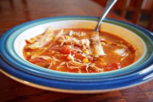 Prepare a tasty soup ahead of time with Slow-Cooker Chicken Enchilada Soup! Cheesiness and corn tortillas make this chicken enchilada soup so special.