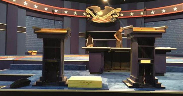 NBC Gaming The Optics With Custom Podium To Enlarge Hillary Clinton's Stature and Visibility…. A comparison of both debate podiums reflects that one is visibly larger, and taller, than the other; and a debate standing platform is evident as the stage is being set up