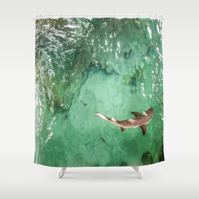A photograph taken while looking above a little shark swimming. #shark #shower #curtain