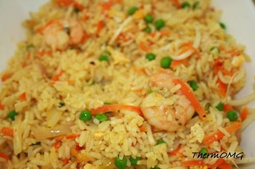 Almost Authentic Chinese Fried Rice  •Long grain white rice (approx 1.5 cups)  •2 large cloves garlic  •1 onion sliced into thin wedges  •1 large carrot grated  •½ cup frozen peas defrosted  •¾ cup bean shoots  •½ cup sliced green onion tops  •100g raw prawns  •2 eggs beaten  •2tsp garlic salt  •2tsp white pepper  •½ cup vegetable oil