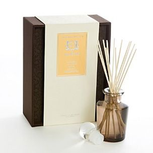 Aquiesse Diffuser - Mandarin Tea - With a smokey brown perfume bottle and 12 bamboo reed sticks.