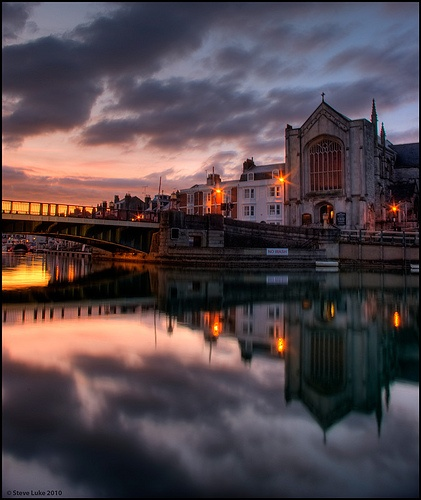 Holy Trinity Church, and the town bridge as viewed from the harbour at sunset, Weymouth, Dorset, UK