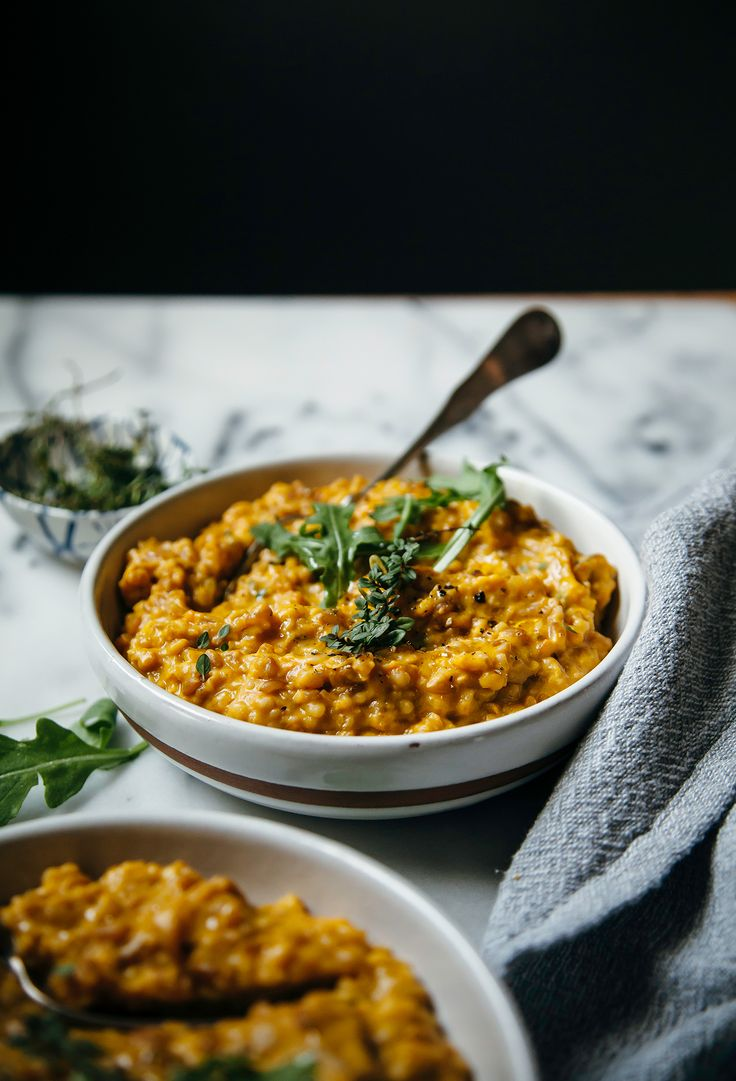 Vegan farrotto with butternut squash, cashews, miso, and herbs is a delicious cold weather supper that is both nourishing and cozy.