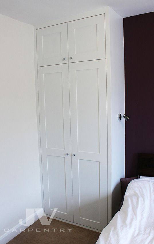 Fitted wardrobe with shaker panelled doors and plain trim around. It was built for a client living in a flat located in North West London.