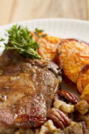 Pork Chops With Sweet Potatoes - Robert Linton/E+/Getty Images