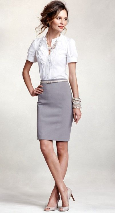 soft gray pencil skirt, white mid-sleeve blouse with ruffle detailing, peep-toe pumps, belt, chunky necklace, and a wrist-full of silver bangles