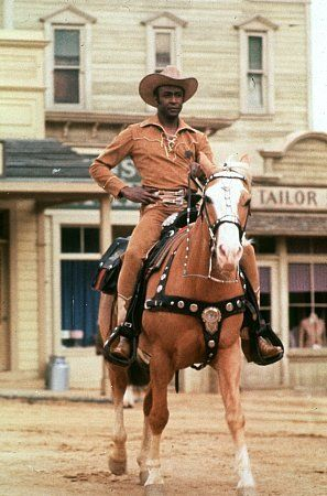 Cleavon Little as the sheriff in BLAZING SADDLES (1974) rode an iconic palomino into town. Pictures & Photos from Blazing Saddles - IMDb