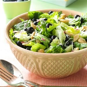 Blueberry Romaine Salad Recipe -I love to bring this delicious salad to school gatherings. The homemade dressing couldn't be simpler, so I whip it up in advance and just give it a quick toss with the other ingredients when I get to any event. —Kris Bristol, Charlotte, Michigan