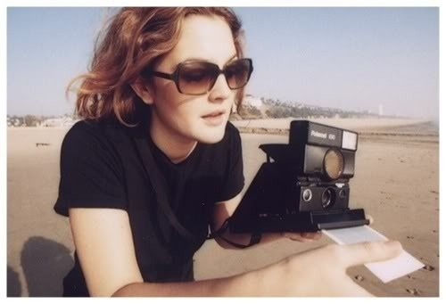 Drew Barrymore with a Polaroid | 33 Celebrities With Their Cameras.. love it!