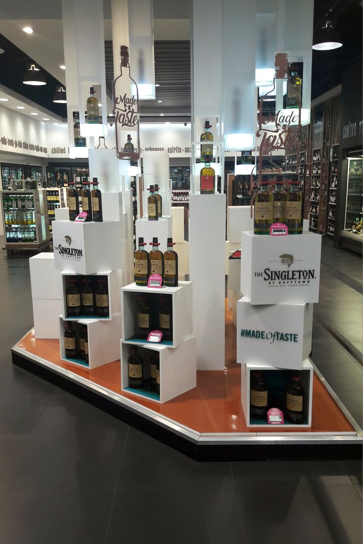 A point of sale display showcasing an effective use of form and colour to highlight the brand and products.