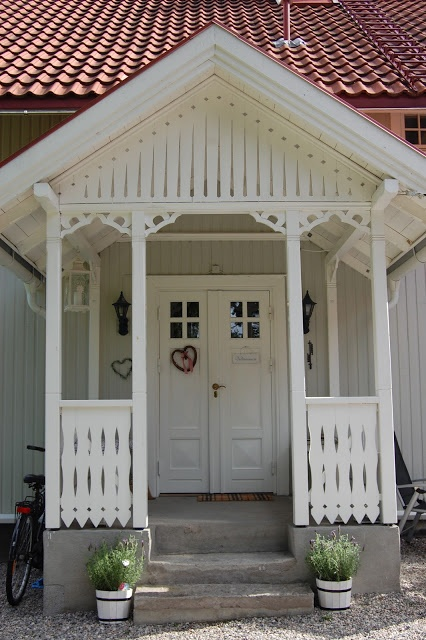 Porch Railing and Gable railing. Also likes the narrow double doors.