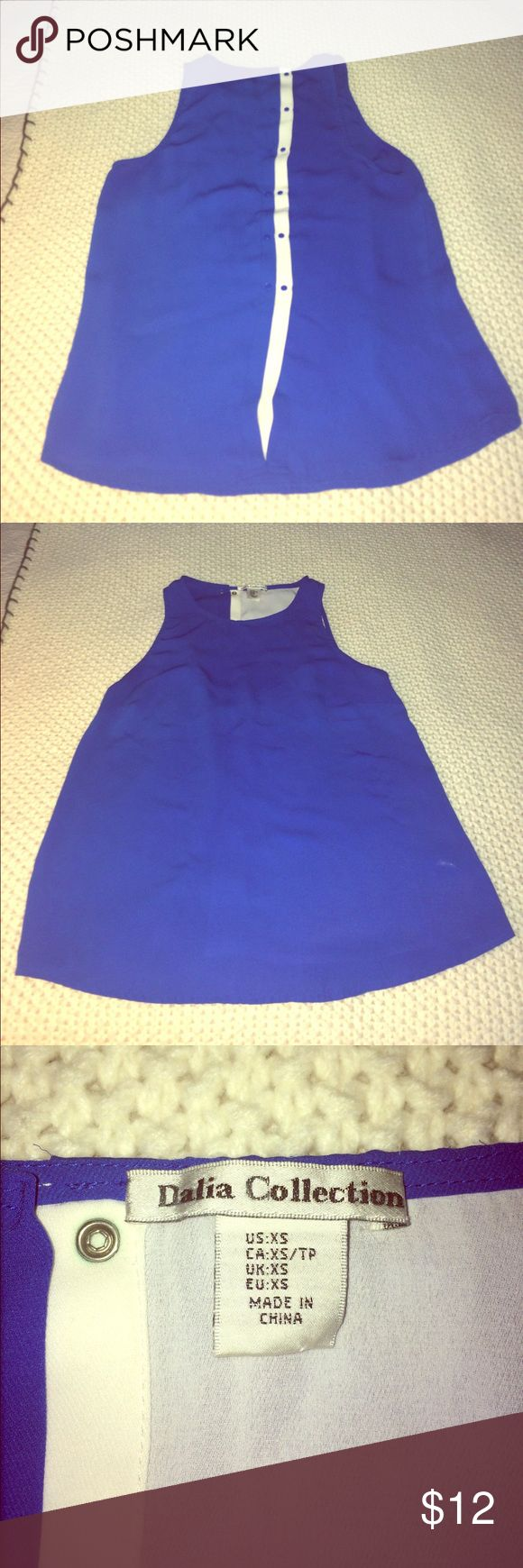 Women's two tone tank top XS Royal blue and white tank top blouse.  100% polyester.  Buttons up back.  There are two sets of buttons up the back so you can adjust the size.  Tag is XS, but also comfortably fits a small.  Thread has pulled on front of top, as seen in last photo. Dalia Collection Tops Tank Tops