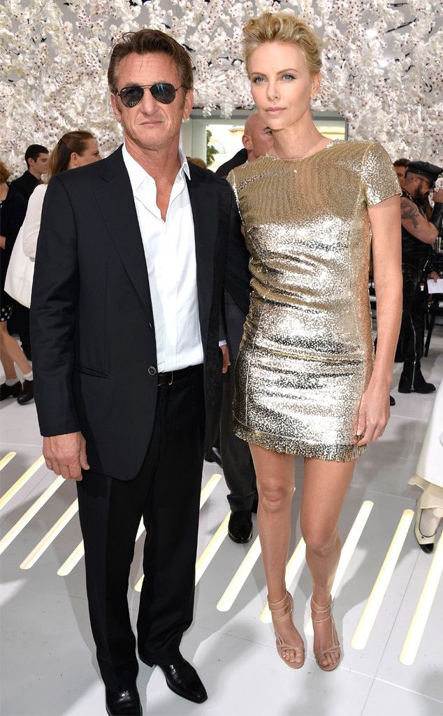 Charlize Theron looks incredible in a gold Dior mini dress with BF Sean Penn!