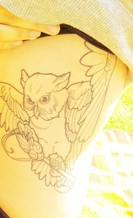 my beloved owl :)  i did it for my mum. her grandma was a native american. their zodiac signs are animals and my mum (who was born in december) is an owl :) well i don't know if i want to add colour- let's see.  i live in germany and my tattoo artist is called 'marco' his shop is called 'vollgetintet' which is some sort of a pun (meaning inked). i hope you like it too :)  juli <3