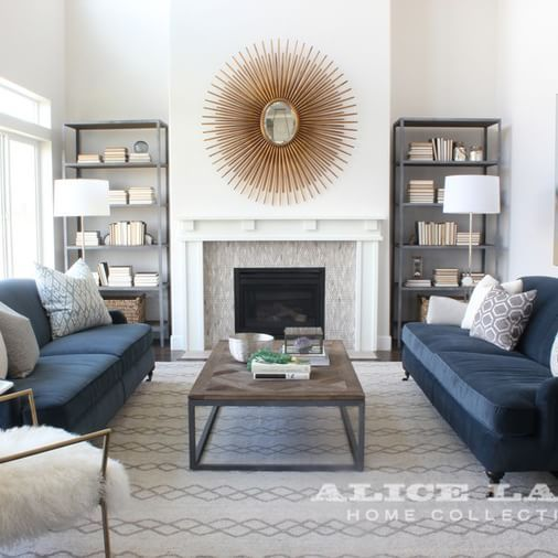 Alice Lane Home Collection | Living Room With Navy Sofas And Sunburst Mirror