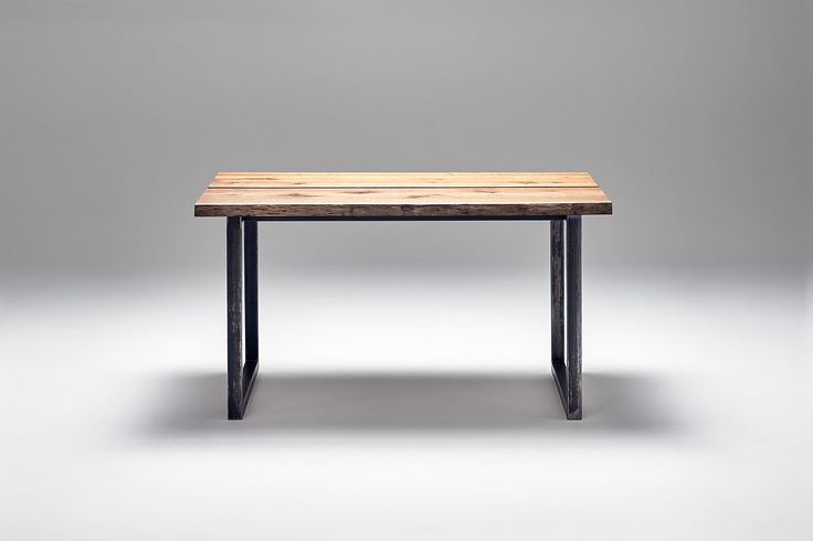 Nevian dining table; Edge. Dark oak and raw steel base.