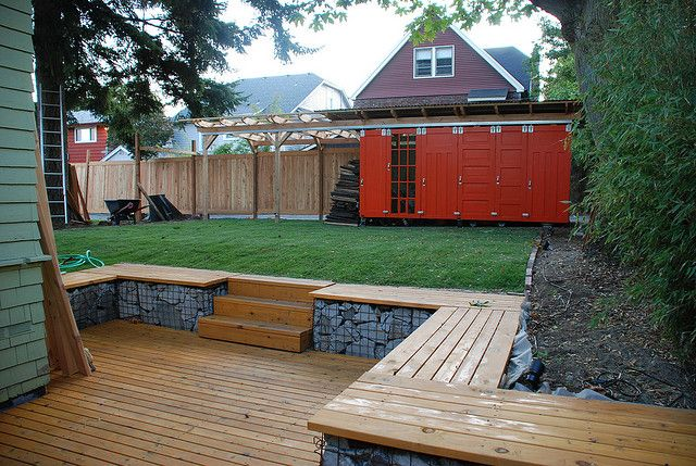 Great use of recycled doors and the ancient idea of a gabion used in a modern way