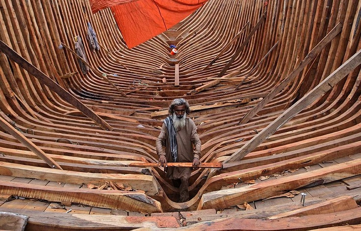A Pakistani carpenter works on a fishing boat at the harbor of Karachi, Pakistan, Monday, June 25, 2012. (AP Photo/Shakil Adil)