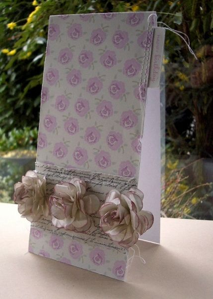 Perfect Papers by Vicky Sheridan. Vicky has a link to her tutorial for making the flowers ... : )