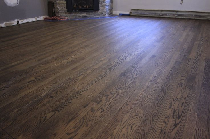 Achieve stain and finish with two coats of Pallmann's Magic oil. White oak floors with 2 parts dark brown mixed with 1 part black Magic oil.