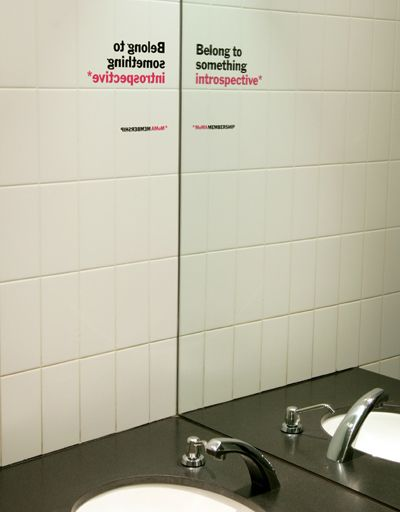 This is a clever example of guerrilla marketing. If you read the slogan in the mirror, it reads correctly. What a great way to get people to pay attention to your ad!