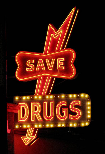 """Neon Drug Store sign. """"Save Drugs'  ..... LOL"""