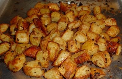 The Herb Potatoes all dice up  olive oil  salt & pepper  tablespoon of rosemary  tablespoon of oregano  sprinkle of paprika,  and garlic is one of Julie's favorite ways to eat potatoes.
