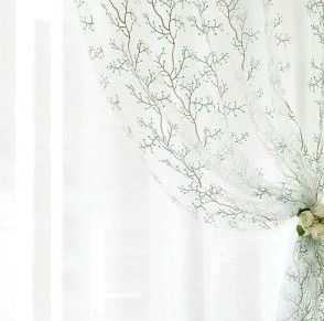 Beautiful voile curtain with flower tieback