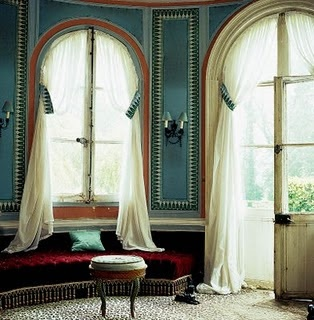 A room with a view, great windows, and ethereal curtains.